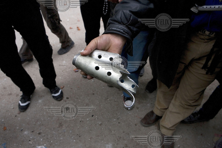 Residents in the Arbin suburb of Damascus show pieces of shrapnel from ordinance fired by the army during a government attempt to restore its control over the area. Protests against the ruling Baathist regime erupted in March 2011and although they were peacefully government forces violently repressed them. In response to being commanded to shoot unarmed civilians large numbers of men deserted the army and formed the Free Syrian Army and an armed uprising began with major clashes taking place in early 2012...