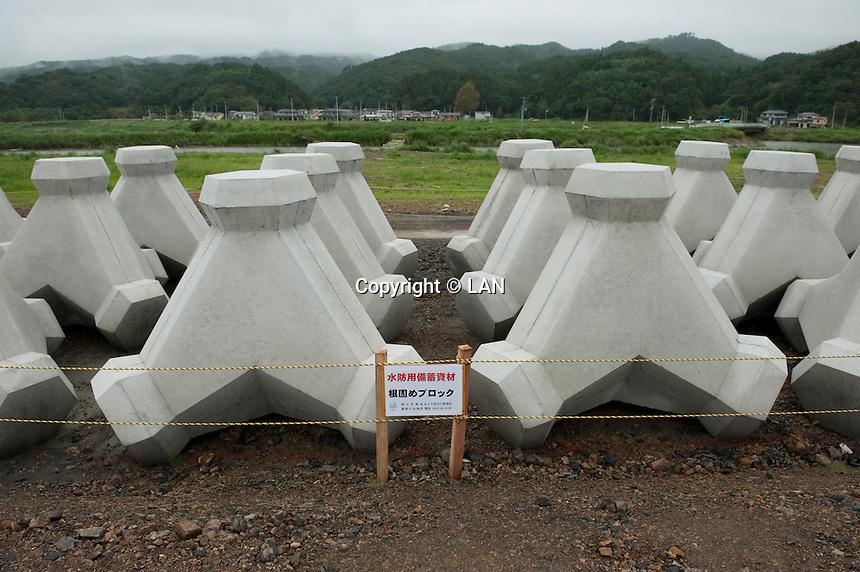 Landscape view of sea wall materials near the Kitakami River following the 311 Tohoku Tsunami in Oppa Bay, Japan  © LAN