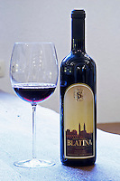 Bottle of Medugorska Blatina red wine 1995. With a glass of wine. Podrum Vinoteka Sivric winery, Citluk, near Mostar. Federation Bosne i Hercegovine. Bosnia Herzegovina, Europe.