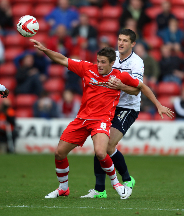 Preston North End's John Mousinho battles with Walsall's Florent Cuvelier ..Football - npower Football League Division One - Walsall v Preston North End - Saturday 22nd September 2012 - Banks's Stadium - Walsall..