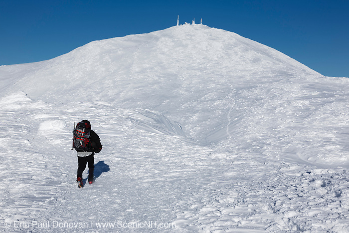 Appalachian Trail - Winter hiker on the summit of Mount Monroe during the winter months in the White Mountains, New Hampshire USA. Mount Washington is in the background.