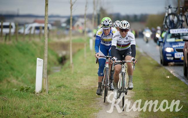 race leaders Michal Kwiatkowski (POL/Ettix-Quickstep) & Jelle Wallays (BEL/Topsport Vlaanderen-Baloise) choose the (muddy) bike path above the cobbles of the Varentstraat<br /> <br /> 70th Dwars Door Vlaanderen 2015