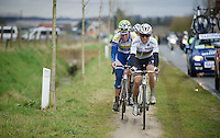 race leaders Michal Kwiatkowski (POL/Ettix-Quickstep) & Jelle Wallays (BEL/Topsport Vlaanderen-Baloise) choose the (muddy) bike path above the cobbles of the Varentstraat<br /> <br /> 70th Dwars Door Vlaanderen 2015