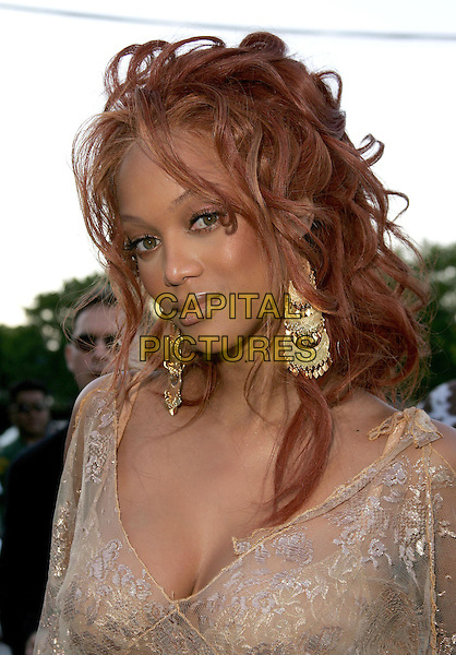 TYRA BANKS.The 2004 Teen Choice Awards held at The Universal Ampitheatre in Universal City, California .August 8, 2004.headshot, portrait, lace, plunging neckline, floral, dangling gold earrings, jewellery.www.capitalpictures.com.sales@capitalpictures.com.Supplied By Capital Pictures
