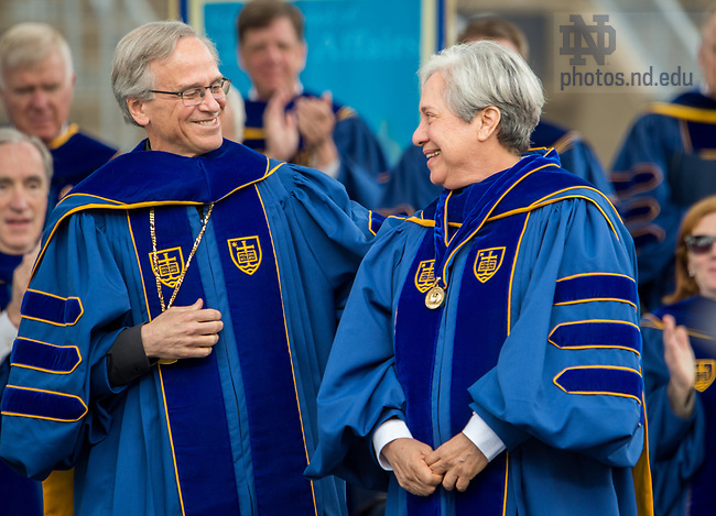 May 20, 2018; 2018 University of Notre Dame President Rev. John I. Jenkins, C.S.C. places the Laetare Medal on Sister Norma Pimentel, M.J. during the 2018 Commencement Ceremony. Sister Norma is the executive director of Catholic Charities of the Rio Grande Valley and longtime advocate for immigrants and refugees. (Photo by Barbara Johnston/University of Notre Dame)
