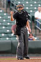 Home plate umpire Gerard Ascani during a game between the Columbus Clippers and Rochester Red Wings at Frontier Field on August 15, 2011 in Rochester, New York.  Columbus defeated Rochester 2-0.  (Mike Janes/Four Seam Images)