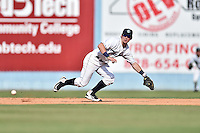 Asheville Tourists shortstop Brendan Rodgers (1) attempts to field a ball during game one of a double header against the Charleston RiverDogs at McCormick Field on July 8, 2016 in Asheville, North Carolina. The RiverDogs defeated the Tourists 10-4 in game one. (Tony Farlow/Four Seam Images)