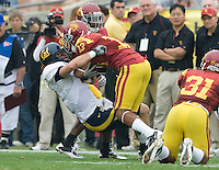 Chris Conte of California tackles Robert Woods of USC during the game at LA Memorial Coliseum in Los Angeles, California.  USC defeated California, 48-14.