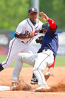 Bryce Harper #34 of the Hagerstown Suns is tagged out at third base by Elmer Reyes #8 of the Rome Braves at State Mutual Stadium on May 2, 2011 in Rome, Georgia.   Photo by Brian Westerholt / Four Seam Images