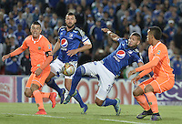 BOGOTA - COLOMBIA -27 -10-2015: Oswaldo Henriquez (Centro Der) jugador de Millonarios disputa el balón con Andres Orozco (Izq) y Daniel Londoño (Der) jugadores de Envigado FC durante por la fecha 17 de la Liga Águila II 2015 jugado en el estadio Nemesio Camacho El Campín de la ciudad de Bogotá./ Oswaldo Henriquez (Center R) player of Millonarios fights for the ball with Andres Orozco (L) and Daniel Londoño players of Envigado FC during the match for the 17th date of the Aguila League II 2015 played at Nemesio Camacho El Campin stadium in Bogota city. Photo: VizzorImage / Gabriel Aponte / Staff.