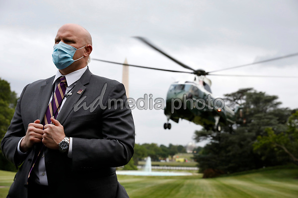 A United States Secret Service agent stands guard as Marine One with US President Donald J. Trump on board arrives on the South Lawn of the White House in Washington, DC on May 21, 2020.<br /> Credit: Yuri Gripas / Pool via CNP/AdMedia