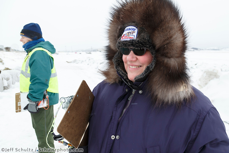 Volunteer Comms, Darla Pindell, waits patiently for a team to arrive in the evening on the ice at the Unalakleet checkpoint on Monday March 16, 2015 during Iditarod 2015.  <br /> <br /> (C) Jeff Schultz/SchultzPhoto.com - ALL RIGHTS RESERVED<br />  DUPLICATION  PROHIBITED  WITHOUT  PERMISSION