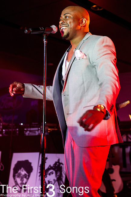Raheem Devaughn performs at the 2014 Essence Festival at the Mercedes-Benz Superdome in New Orleans, Louisiana.