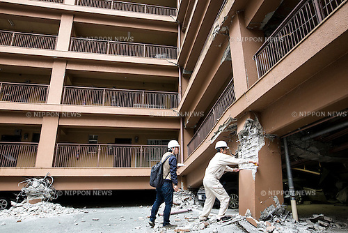 KUMAMOTO, JAPAN - APRIL 16: City officers check cracked foundation of an apartment in Denmachi, Kumamoto prefecture, Japan are seen on Saturday morning on April 16, 2016. The area was severely hit by a magnitude-6.5 quake Thursday night and followed by magnitude-7.3 quake on Saturday early morning on April 16, 2016 in Kumamoto prefecture, Japan. (Photo by Richard A. de Guzman/AFLO)