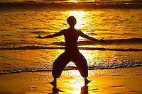 Sunset Yoga On The Beach At Low Tide