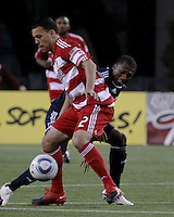 FC Dallas midfielder/forward Daniel Hernandez (2) controls the ball as New England Revolution midfielder Sainey Nyassi (14) prepares to tackle him. The New England Revolution drew FC Dallas 1-1, at Gillette Stadium on May 1, 2010