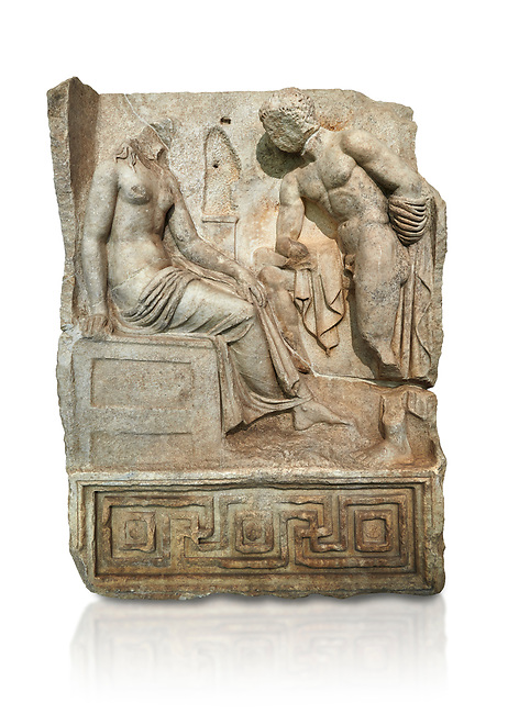 """Roman Sebasteion relief  sculpture of Io and Argos Aphrodisias Museum, Aphrodisias, Turkey.     Against a white background.<br /> <br /> A powerful hero is folding a sword gazing closely at a half naked and dishevelled young heroine who sits on a chest like stool. Between, on a pillar base stood a small, separately added statue of a goddess ( now missing). The scene follows a scheme used in the relief panels """"Io guarded by Argos"""". Io was one of Zeus's lovers, and Argos was a watchful giant sent to guard her by Hera, Zeus's wife."""