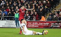 Emre Can of Liverpool  hits a shot past Federico Fernandez of Swansea City  during the Premier League match between Swansea City and Liverpool at the Liberty Stadium, Swansea, Wales on 22 January 2018. Photo by Mark Hawkins / PRiME Media Images.