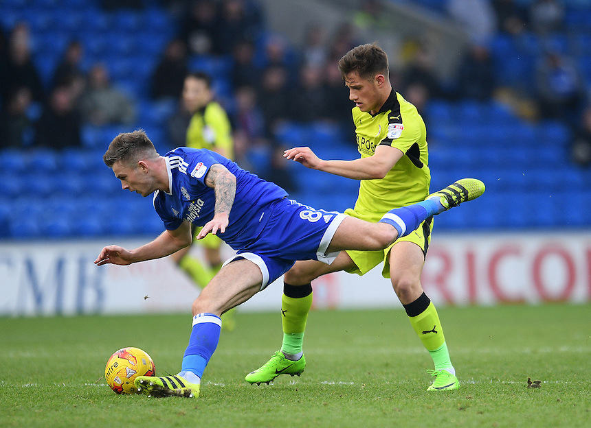 Cardiff City's Joe Ralls is fouled by Rotherham United's Jerry Yates<br /> <br /> Photographer Ashley Crowden/CameraSport<br /> <br /> The EFL Sky Bet Championship - Cardiff City v Rotherham United - Saturday 18th February 2017 - Cardiff City Stadium - Cardiff<br /> <br /> World Copyright &copy; 2017 CameraSport. All rights reserved. 43 Linden Ave. Countesthorpe. Leicester. England. LE8 5PG - Tel: +44 (0) 116 277 4147 - admin@camerasport.com - www.camerasport.com