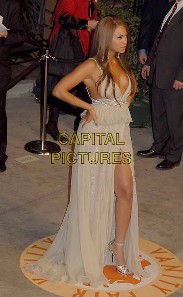 BEYONCE KNOWLES.The 2007 Vanity Fair Oscar Party Hosted by Graydon Carter held at Morton's, West Hollywood, California, USA, 25 February 2007..oscars full length leg thigh split gold beige dress hands on hips.CAP/ADM/GB.©Gary Boas/AdMedia/Capital Pictures.