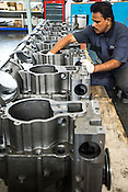 Workers and engineers work on the diesel engines on the factory floor of the MAN diesel and turbo factory in Aurangabad in Maharashtra, India.