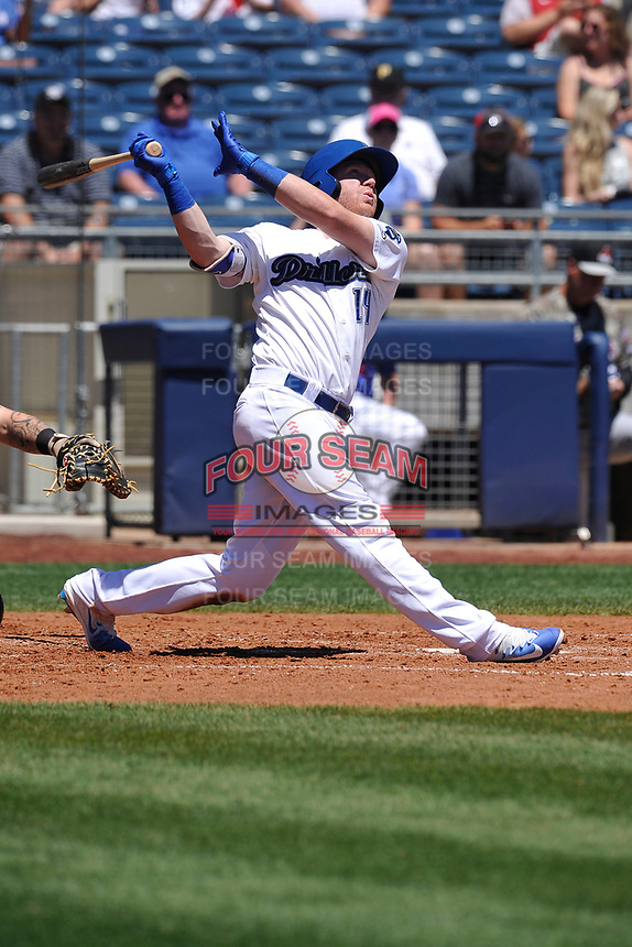 Tulsa Drillers catcher Paul Hoenecke (14) swings during a game against the Arkansas Travelers at Oneok Field on May 21, 2017 in Tulsa, Oklahoma.  The Drillers won 13-6. (Dennis Hubbard/Four Seam Images)