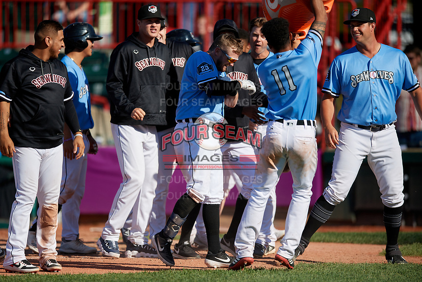 Erie SeaWolves Derek Hill (11) dumps the water bucket over Kody Eaves (22) head after a three run walk-off home run in the bottom of the eleventh inning during an Eastern League game against the Akron RubberDucks on June 2, 2019 at UPMC Park in Erie, Pennsylvania.  Erie defeated Akron 8-5 in eleven innings, the second game of a doubleheader.  (Mike Janes/Four Seam Images)
