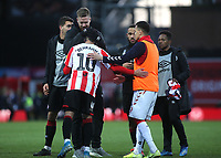 Pontus Jansson of Brentford hugs Said Benrahma at the final whistle to celebrate their 3-2 victory during Brentford vs Middlesbrough, Sky Bet EFL Championship Football at Griffin Park on 8th February 2020
