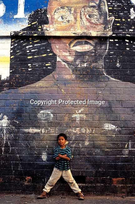 dienvgr0020 Environment.  A graffiti mural of Tupac Shackur in a gang area on September 15, 2002 in Manenberg outside Cape Town, South Africa. Manenberg is a gang area and one of the most dangerous places in South Africa, where rival gangs shoot at each other daily and where children often are struck in crossfire. This area is dominated by the HL:s Hard Livings, and are fighting the rival gang, the Americans..©Per-Anders Pettersson/ iAfrika Photos