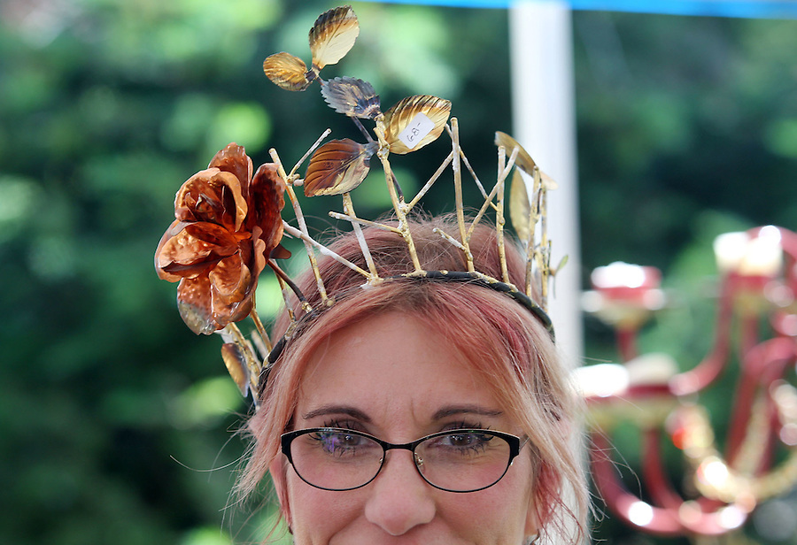 Local artist Noelle Zimel wears a crown she created, at the annual Recycled Art Fair in Esther Short Park in downtown Vancouver Sunday June 26, 2016. The crown cost $68,00. (Photo by Natalie Behring for the Columbian)