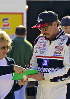 Dale Earnhardt signs an autograph during practice for the Daytona 500, Daytona International Speedway, Daytona Beach, FL, February, 2001.  (Photo by Brian Cleary/www.bcpix.com)