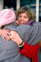 Cousins age 55 hugging after mothers funeral.  St Paul  Minnesota USA