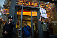 NEW YORK, NY - APRIL 5: A customer (C) exits Wells Fargo Bank as an activist and Indigenous people begin the overnight camp out in front of Wells Fargo branch on April 5, 2017 in Soho, New York City. Activists are looking to drive mayor Bill De Blasio attention to divest founds from banks like Wells Fargo &amp; Company which has caused controversy for their investment in the Dakota Access Pipeline (DAPL)&mdash;a project that will be constructed through land owned by the Standing Rock Indian Reservation and covers land stretching from North Dakota to central Illinois. Photo by VIEWpress/Eduardo MunozAlvarez<br /> <br /> divest