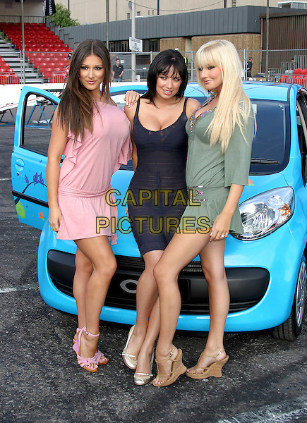 LUCY PINDER, SOPHIE HOWARD & MICHELLE MARSH .At the Max Power Live car show, Birmingham NEC, Birmingham, July 1st 2005..Full length models girls blue car.Ref: JEZ.www.capitalpictures.com.sales@capitalpictures.com.©Jez Self/Capital Pictures