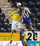 Michael Nelson beats Frazer Wright to score for Kilmarnock.