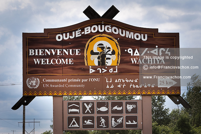 A sign directs travelers to the Ouje-Bougoumou Cree reserve July 10, 2009. Designed by famoust architect Douglas Cardinal, Ouje-Bougoumou was built in 1992 and won recognition and awards for its modern concepts combining economic sustainability, environmental conservation, and design
