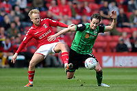 Ben Reeves of Charlton Athletic and Scunthorpe United's Josh Morris challenge for the ball during Charlton Athletic vs Scunthorpe United, Sky Bet EFL League 1 Football at The Valley on 14th April 2018