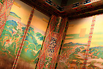Colorful ornaments of painted walls of a historic Japanese Buddhist temple interior. Byodo-in, Kyoto, Japan.