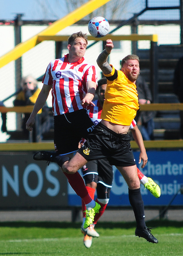 Lincoln City's Callum Howe vies for possession with Southport's Andy Bishop<br /> <br /> Photographer Andrew Vaughan/CameraSport<br /> <br /> Football - Vanarama National League - Southport v Lincoln City - Saturday 16th April 2016 - Merseyrail Community Stadium - Southport<br /> <br /> &copy; CameraSport - 43 Linden Ave. Countesthorpe. Leicester. England. LE8 5PG - Tel: +44 (0) 116 277 4147 - admin@camerasport.com - www.camerasport.com
