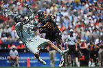 28 MAY 2012:  Davis Butts (7) of Loyola University is hit by Brian Cooper (40) after scoring against the University of Maryland during the Division I Men's Lacrosse Championship held at Gillette Stadium in Boston, MA.  Loyola defeated Maryland 9-3 for the national title.  Larry French/NCAA Photos