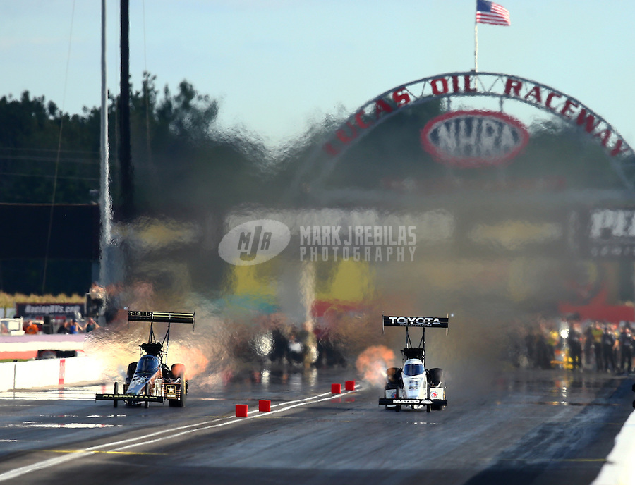 Sep 3, 2016; Clermont, IN, USA; NHRA top fuel driver Tony Schumacher (left) races alongside Antron Brown during qualifying for the US Nationals at Lucas Oil Raceway. Mandatory Credit: Mark J. Rebilas-USA TODAY Sports