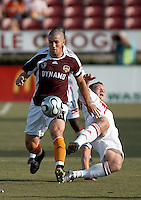 Houston Dynamo defender Wade Barrett (24) avoids the tackle by Chicago Fire forward Chad Barrett (9).  Chicago Fire beat Houston Dynamo 1-0 at Robertson Stadium in Houston, TX on April 29, 2007.