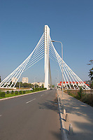 The Millennium Bridge is a cable stayed bridge that spans Moraca River with cables that form a graphic pattern and a single central supporting column. Podgorica capital. Montenegro, Balkan, Europe. Designed by Mladen Ulicevic.