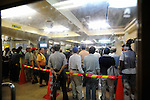 Around 30 homeless men line up to enquire about possible work placements at the Nishinari Labor Welfare Center in the Kamagasaki district of Osaka, Japan. Thousands of homeless people flock to the center daily in hope of securing day labor work, such as hands on building sites - jobs that pay around 50 pounds per day..
