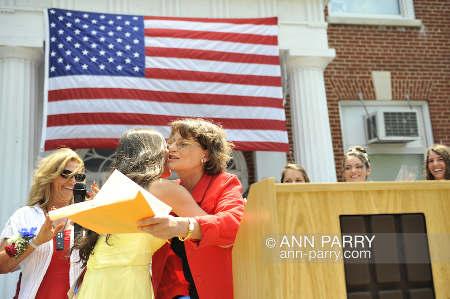 Miss Wantagh Pageant ceremony, a long-time Independence Day tradition on Long Island, is Wednesday, July 4, 2012, at Wantagh School, New York, USA. Nassau County Clerk Maureen O'Connell (in red jacket) announced winner Hailey Orgass, Miss Wantagh 2012. At extreme left is Ella Stevens, the pageant Coordinator