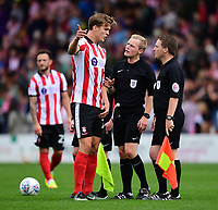 Lincoln City's Sean Raggett speaks to Referee Gavin Ward at the final whistle<br /> <br /> Photographer Chris Vaughan/CameraSport<br /> <br /> The EFL Sky Bet League Two - Lincoln City v Morecambe - Saturday August 12th 2017 - Sincil Bank - Lincoln<br /> <br /> World Copyright &copy; 2017 CameraSport. All rights reserved. 43 Linden Ave. Countesthorpe. Leicester. England. LE8 5PG - Tel: +44 (0) 116 277 4147 - admin@camerasport.com - www.camerasport.com