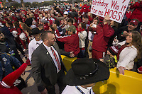 Arkansas Democrat-Gazette/BENJAMIN KRAIN --12/29/2014--<br /> Coach Bret Bielema passes through a crowd of fans outside RNG Stadium in Houston before Monday night's Texas Bowl.
