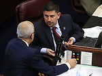 Nevada Senate Democrats Mo Denis, left, and Mark Manendo work on the Senate floor in the final hours of the session at the Legislative Building in Carson City, Nev., on Monday, June 1, 2015. <br /> Photo by Cathleen Allison