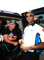Jul. 17, 2010; Sonoma, CA, USA; NHRA top fuel dragster driver Rod Fuller (left) with Rashed al Quibisi during qualifying for the Fram Autolite Nationals at Infineon Raceway. Mandatory Credit: Mark J. Rebilas-