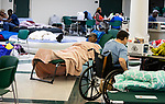 TALLAHASSEE, FL - OCTOBER 10: People try to get some rest at Lincoln High School as Hurricane Michael approaches on October 10, 2018 in Tallahassee, Florida. (Photo by Mark Wallheiser/Getty Images)